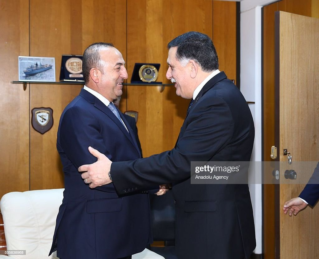 Turkish Foreign Minister Mevlut Cavusoglu (L) and Chairman of the Presidential Council of Libya Fayez al-Sarraj (R) shake hands during their meeting in Tripoli, Libya on May 30, 2016.