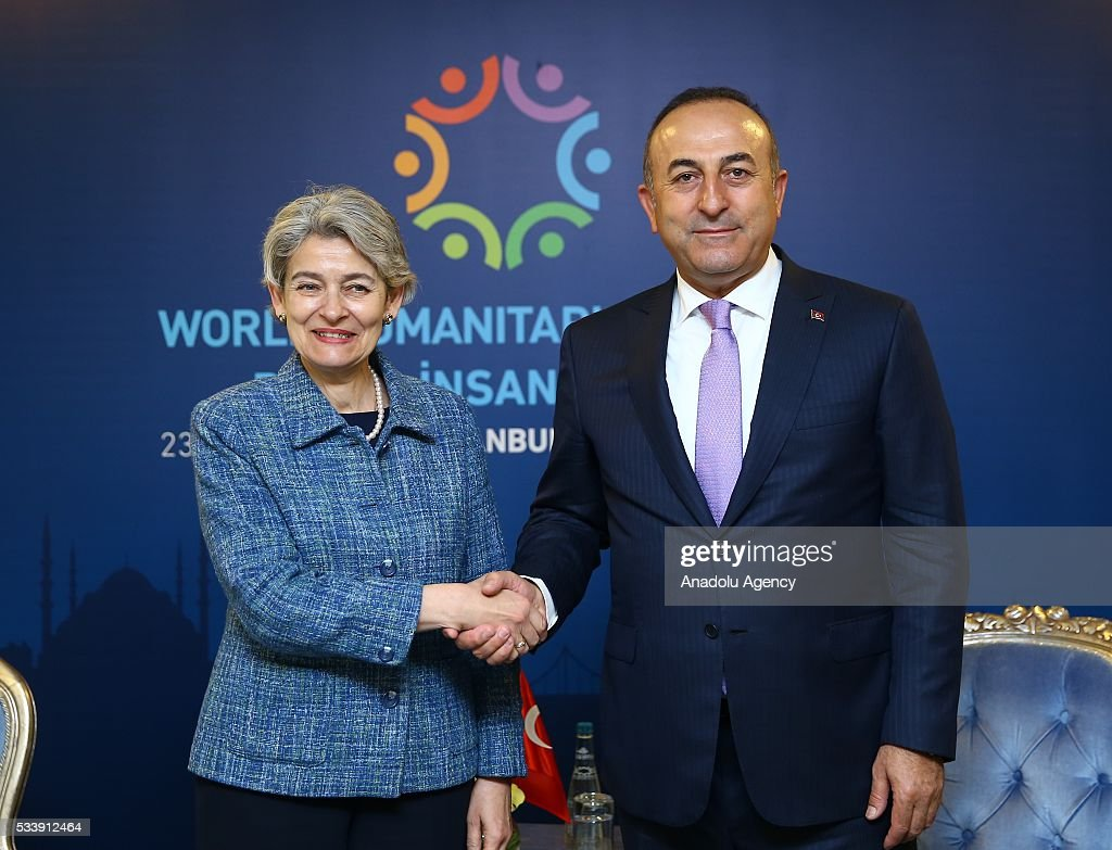 Turkish Foreign Minister Mevlut Cavusoglu (R) and Director-General of UNESCO Irina Bokova (L) shake hands as they pose for a photograph before bilateral meeting within World Humanitarian Summit in Istanbul, Turkey on May 24, 2016.