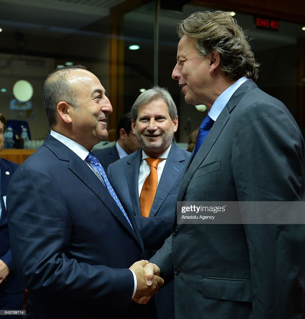 Turkish Foreign Minister Mevlut Cavusoglu (L) and Foreign Affairs Minister of Holland Bert Koenders shake hands at the Chapter 33 on financial and budgetary provisions as part of the EU-Turkey Intergovernmental Accession Conference in Brussels, Belgium on June 30, 2016.