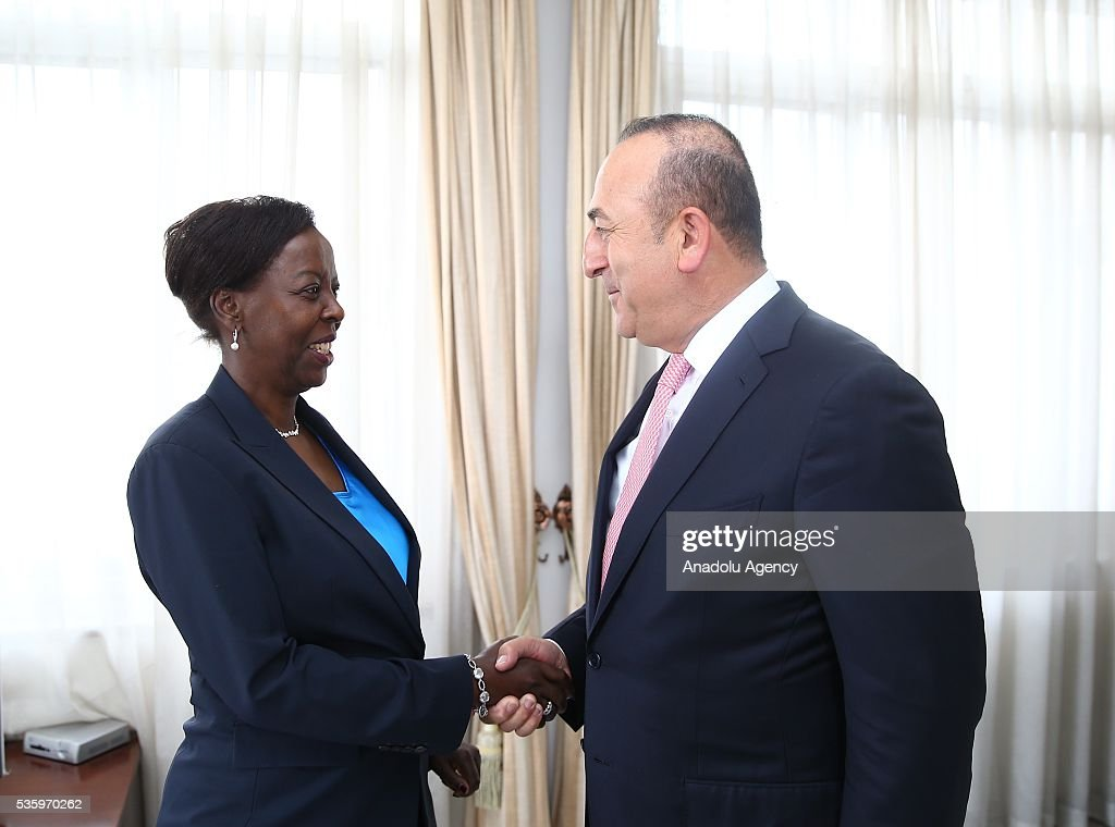 Turkish Foreign Minister Mevlut Cavusoglu (R) and Foreign Minister of Rwanda Louise Mushikiwabo (L) shake hands prior their meeting in Kigali, Rwanda on May 31, 2016.