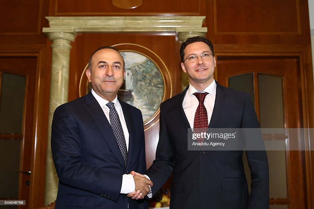 Turkish Foreign Minister Mevlut Cavusoglu (L) and Minister of Foreign Affairs of Bulgaria, Daniel Mitov (R) shake hands before their meeting in Sochi, Russia on July 01, 2016.