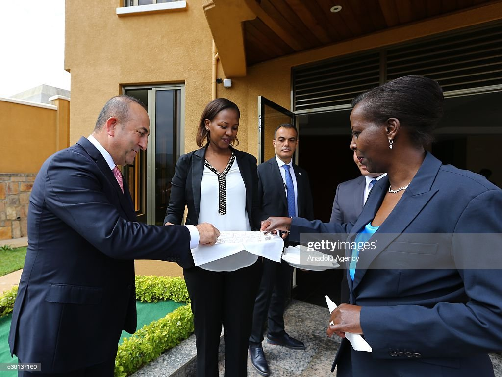Turkish Foreign Minister Mevlut Cavusoglu (L) and Minister of Foreign Affairs and Cooperation of Rwanda Louise Mushikiwabo (R) attend the opening ceremony of the new Rwanda Embassy building in Kigali, Rwanda on May 31, 2016.