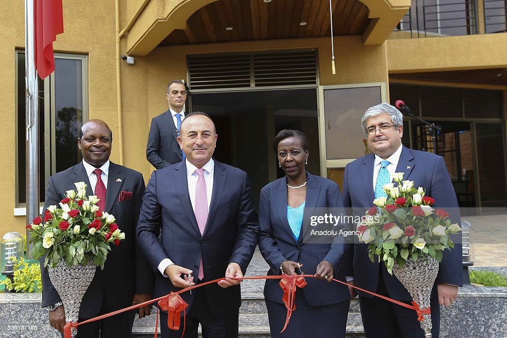 Turkish Foreign Minister Mevlut Cavusoglu (2nd L) and Minister of Foreign Affairs and Cooperation of Rwanda Louise Mushikiwabo (2nd R) attend the opening ceremony of the new Rwanda Embassy building in Kigali, Rwanda on May 31, 2016.