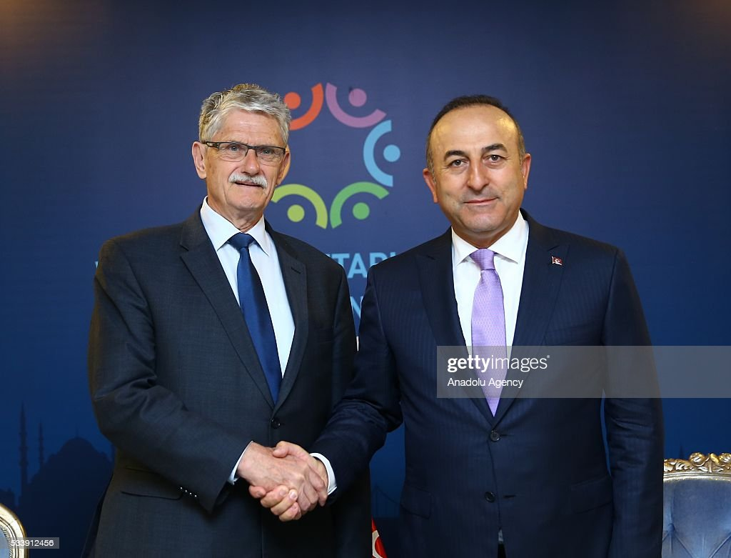 Turkish Foreign Minister Mevlut Cavusoglu (R) and President of the United Nations General Assembly Mogens Lykketoft (L) shake hands during the World Humanitarian Summit in Istanbul, Turkey on May 24, 2016.