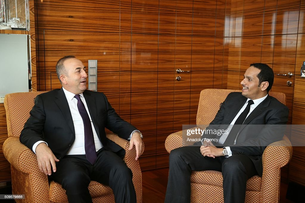 Turkish Foreign Minister Mevlut Cavusoglu (L) and Qatar's Foreign Minister Sheikh Mohammed bin Abdulrahman bin Jassim Al-Thani (R) are seen during International Syrian Support Group Meeting in Munich, Germany on February 11, 2016.
