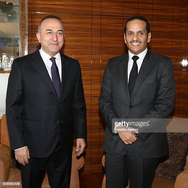 Turkish Foreign Minister Mevlut Cavusoglu and Qatar's Foreign Minister Sheikh Mohammed bin Abdulrahman bin Jassim AlThani are seen during...