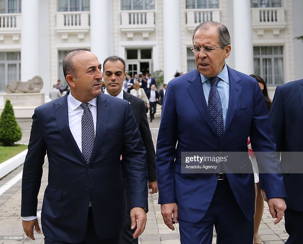 Turkish Foreign Minister Mevlut Cavusoglu (L) and Russia's Foreign Minister Sergey Lavrov (R) arrive a meeting of the Council of Ministers for Foreign Affairs of the Black Sea Economic Cooperation Organization (BSEC) member-states in Sochi, Russia on July 1, 2016.