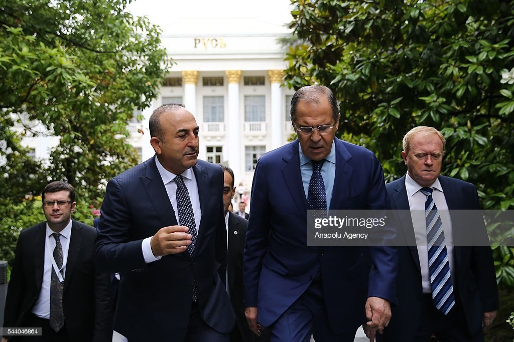 Turkish Foreign Minister Mevlut Cavusoglu (2nd L) and Russia's Foreign Minister Sergey Lavrov (2nd R) arrive a meeting of the Council of Ministers for Foreign Affairs of the Black Sea Economic Cooperation Organization (BSEC) member-states in Sochi, Russia on July 1, 2016.