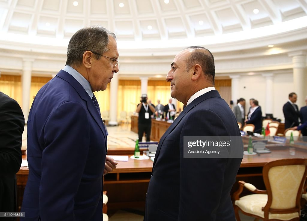 Turkish Foreign Minister Mevlut Cavusoglu (R) and Russia's Foreign Minister Sergey Lavrov (L) attend a meeting of the Council of Ministers for Foreign Affairs of the Black Sea Economic Cooperation Organization (BSEC) member-states in Sochi, Russia on July 1, 2016.