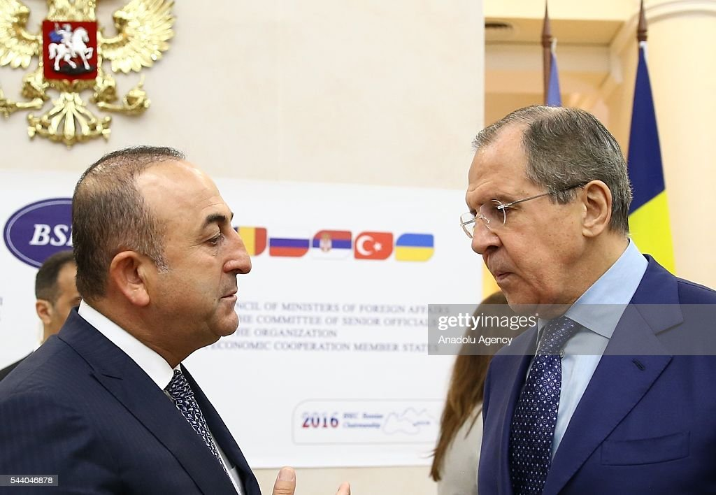 Turkish Foreign Minister Mevlut Cavusoglu (L) and Russia's Foreign Minister Sergey Lavrov (R) attend a meeting of the Council of Ministers for Foreign Affairs of the Black Sea Economic Cooperation Organization (BSEC) member-states in Sochi, Russia on July 1, 2016.
