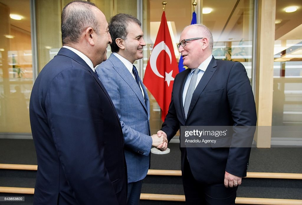 Turkish Foreign Minister Mevlut Cavusoglu (L) and Turkey's EU Minister Omer Celik (C) meet with First Vice President of the European Commission Frans Timmermans (R) in Brussels, Belgium on June 30, 2016.