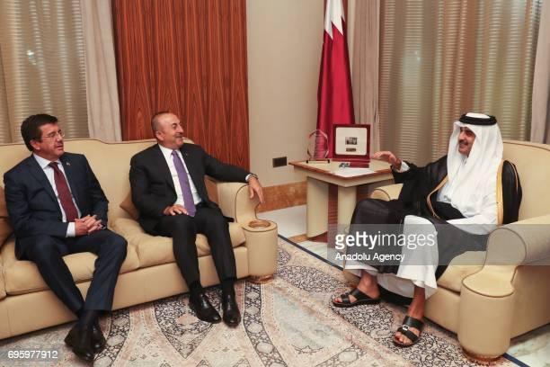 Turkish Foreign Minister Mevlut Cavusoglu and Turkish Economy Minister Nihat Zeybekci meet with Emir of Qatar Tamim bin Hamad Al Thani in Doha Qatar...