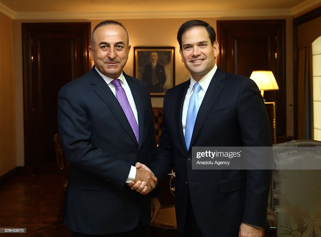 Turkish Foreign Minister Mevlut Cavusoglu (L) and US Senator Marco Rubio (R) shake hands after their meeting in Ankara, Turkey on May 5, 2016.