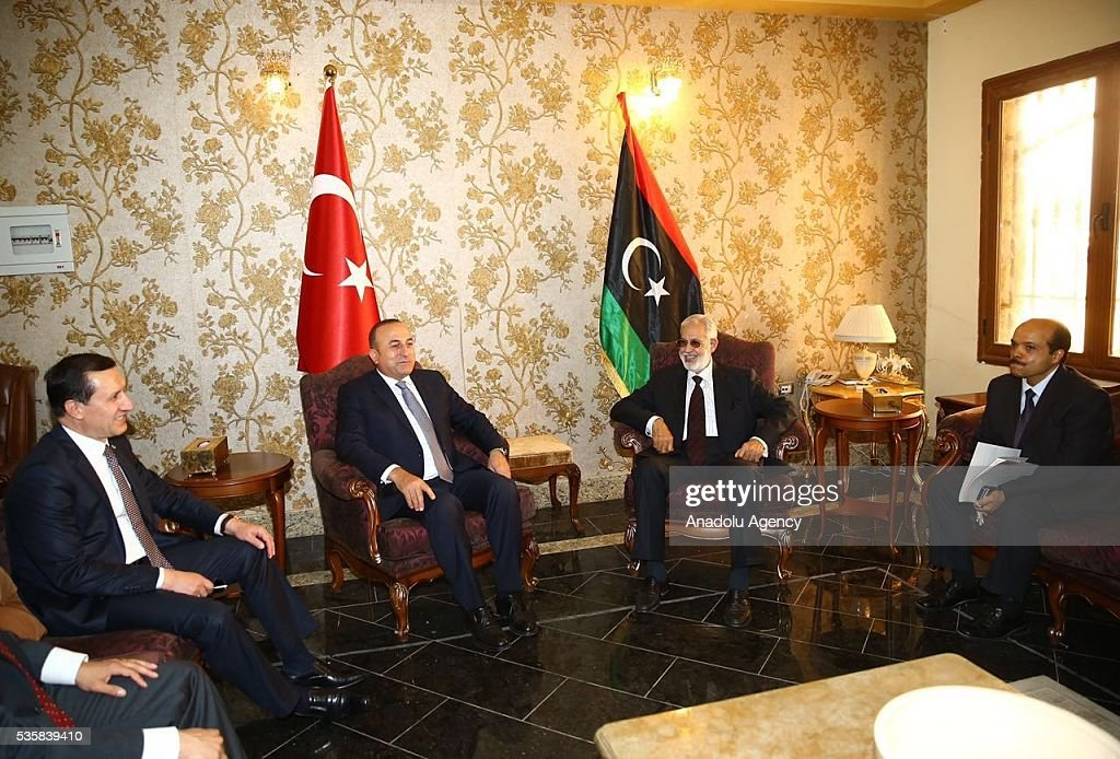 Turkish Foreign Minister Mevlut Cavusoglu (C-L) attends a meeting with Libyan Foreign Minister Mohamed Siala (C-R) in Tripoli, Libya on May 30, 2016.