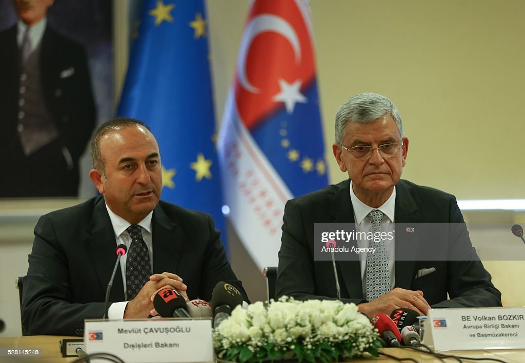 Turkish Foreign Minister Mevlut Cavusoglu (L) attends a press conference with Turkish EU Minister Volkan Bozkir (R) in Ankara, Turkey on May 4, 2016.