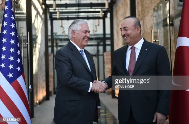 Turkish Foreign Minister Mevlut Cavusoglu greets US Secretary of State Rex Tillerson upon his arrival for their meeting on July 9 2017 in Istanbul US...