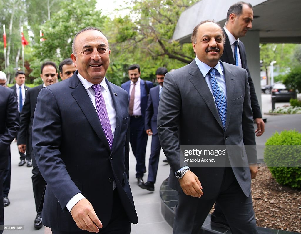 Turkish Foreign Minister Mevlut Cavusoglu (L) meets Qatar's Minister of State for Defense Khalid bin Mohammad Al Attiyah (R) in Ankara, Turkey on May 5, 2016.