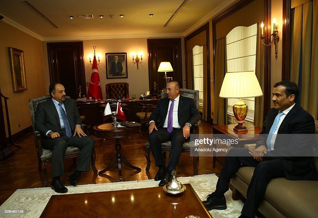 Turkish Foreign Minister Mevlut Cavusoglu (C) meets Qatar's Minister of State for Defense Khalid bin Mohammad Al Attiyah (L) in Ankara, Turkey on May 5, 2016.