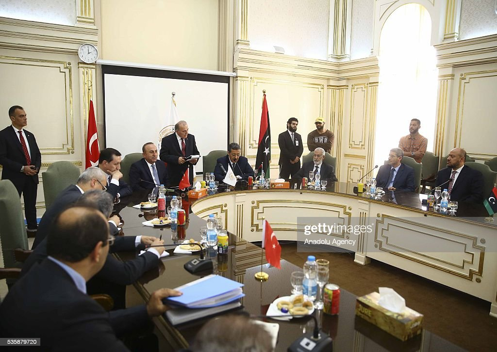 Turkish Foreign Minister Mevlut Cavusoglu (5th L) meets Tripoli Mayor Abdurrauf Hasan Mohamed Beytulmal (4th R) and city councilors as Libyan Foreign Minister Mohamed Taha Siala (3rd R) and Libya representative of Turkey and Justice and Development Party (AKP) deputy Emrullah Isler (4th L) attend the meeting in Tripoli, Libya on May 30, 2016.