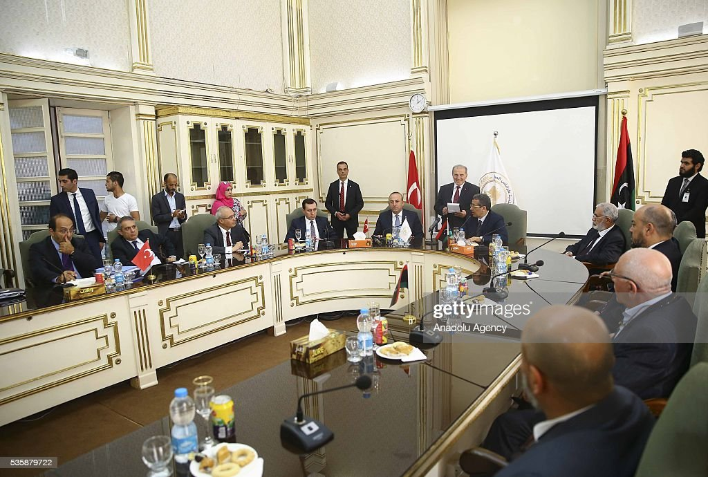 Turkish Foreign Minister Mevlut Cavusoglu (5th L) meets Tripoli Mayor Abdurrauf Hasan Mohamed Beytulmal (5th R) and city councilors as Libyan Foreign Minister Mohamed Taha Siala (4th R) and Libya representative of Turkey and Justice and Development Party (AKP) deputy Emrullah Isler (4th L) attend the meeting in Tripoli, Libya on May 30, 2016.