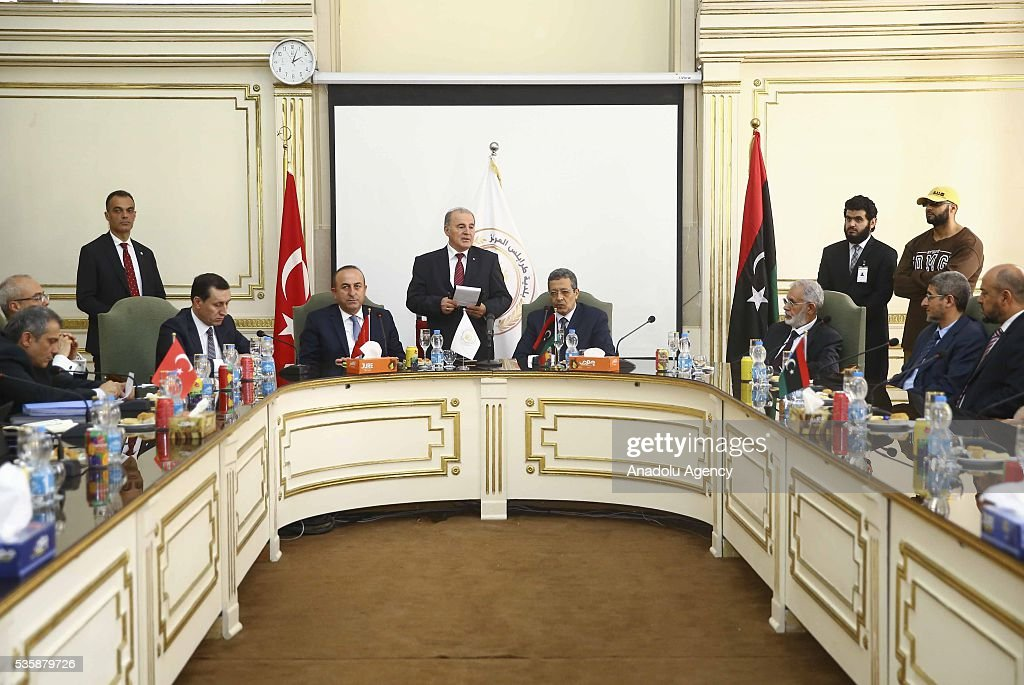 Turkish Foreign Minister Mevlut Cavusoglu (center L) meets Tripoli Mayor Abdurrauf Hasan Mohamed Beytulmal (center R) and city councilors as Libyan Foreign Minister Mohamed Taha Siala (3rd R) and Libya representative of Turkey and Justice and Development Party (AKP) deputy Emrullah Isler (3rd L) attend the meeting in Tripoli, Libya on May 30, 2016.