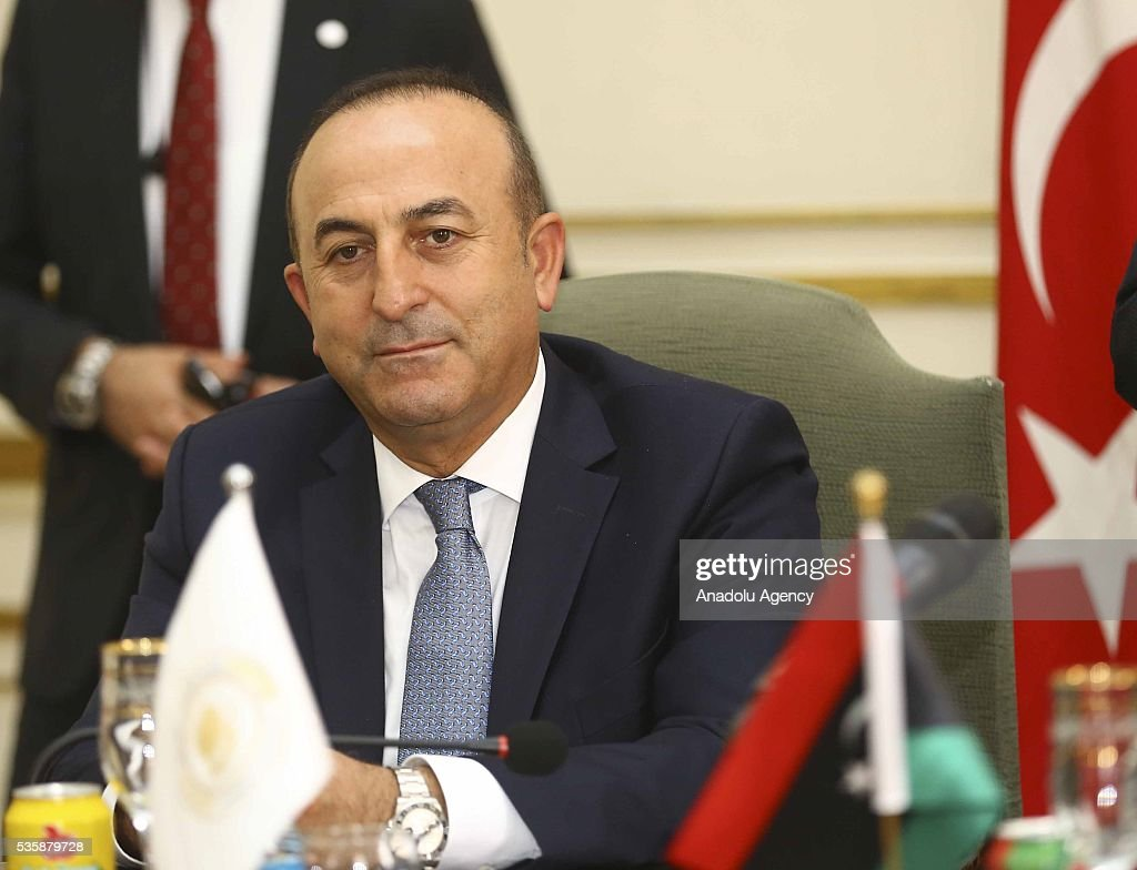 Turkish Foreign Minister Mevlut Cavusoglu (C) meets Tripoli Mayor Abdurrauf Hasan Mohamed Beytulmal and city councilors as Libyan Foreign Minister Mohamed Taha Siala and Libya representative of Turkey and Justice and Development Party (AKP) deputy Emrullah Isler attend the meeting in Tripoli, Libya on May 30, 2016.
