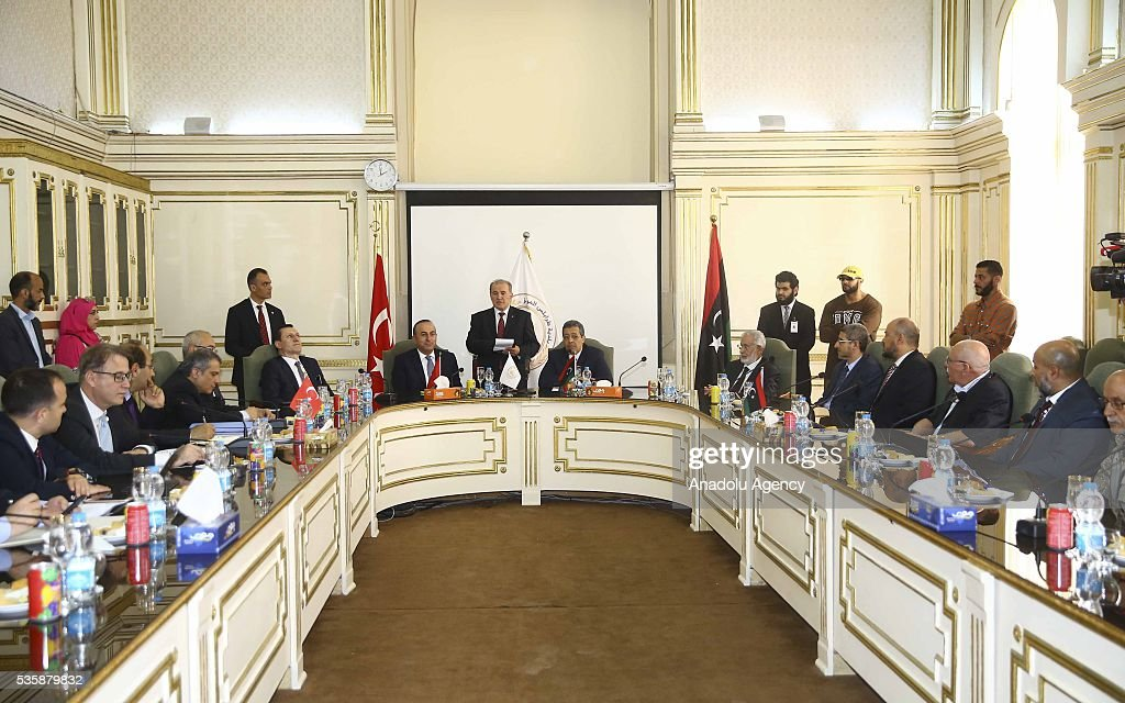 Turkish Foreign Minister Mevlut Cavusoglu (center L) meets Tripoli Mayor Abdurrauf Hasan Mohamed Beytulmal (center R) and city councilors as Libyan Foreign Minister Mohamed Taha Siala (6th R) and Libya representative of Turkey and Justice and Development Party (AKP) deputy Emrullah Isler (6th L) attend the meeting in Tripoli, Libya on May 30, 2016.