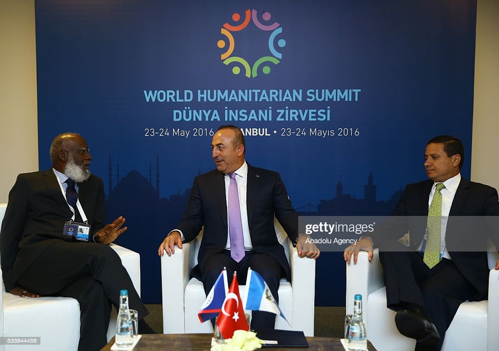 Turkish Foreign Minister Mevlut Cavusoglu (C) meets with Minister of Foreign Affairs of Belize Wilfred Elrington (L) and Minister of Foreign Affairs of Guatemala Carlos Morales (R) during a trilateral meeting, held within World Humanitarian Summit in Istanbul, Turkey on May 24, 2016.