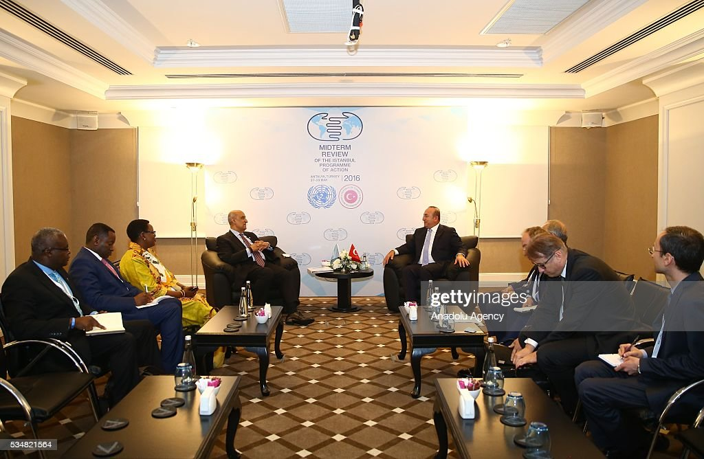 Turkish Foreign Minister Mevlut Cavusoglu (C-R) meets with United Nations Secretary-General's Special Adviser on Africa Maged A. Abdelaziz (C-L) during the Midterm Review of the Istanbul Programme of Action at Titanic Hotel in Antalya, Turkey on May 28, 2016. The Midterm Review conference for the Istanbul Programme of Action for the Least Developed Countries takes place in Antalya, Turkey from 27-29 May 2016.