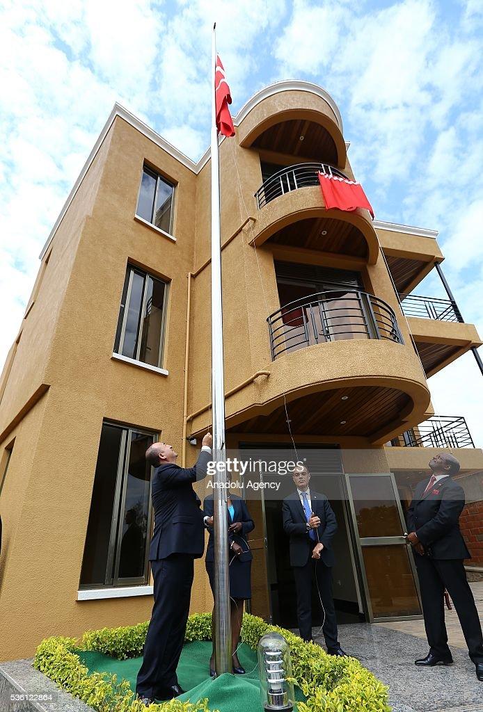 Turkish Foreign Minister Mevlut Cavusoglu raise the Turkish flag during the opening ceremony of the new Rwanda Embassy building in Kigali, Rwanda on May 31, 2016.