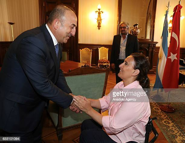 Turkish Foreign Minister Mevlut Cavusoglu shakes hand with Argentina's VicePresident Gabriela Michetti before their meeting at Casa Rosada in Buenos...