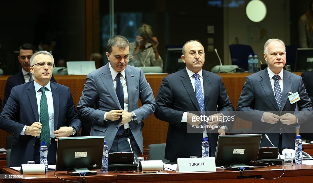 Turkish Foreign Minister Mevlut Cavusoglu (R 2), Turkish Finance Minister Naci Agbal (L) and Turkey's EU Minister Omer Celik (L 2) stand in silence for the victims of the terrorist attack at Ataturk International Airport during the Chapter 33 on financial and budgetary provisions as part of the EU-Turkey Intergovernmental Accession Conference in Brussels, Belgium on June 30, 2016.