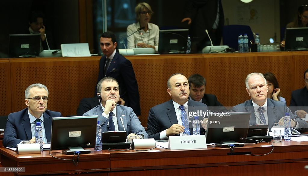Turkish Foreign Minister Mevlut Cavusoglu (R 2), Turkish Finance Minister Naci Agbal (L) and Turkey's EU Minister Omer Celik (L 2) attend the Chapter 33 on financial and budgetary provisions as part of the EU-Turkey Intergovernmental Accession Conference in Brussels, Belgium on June 30, 2016.