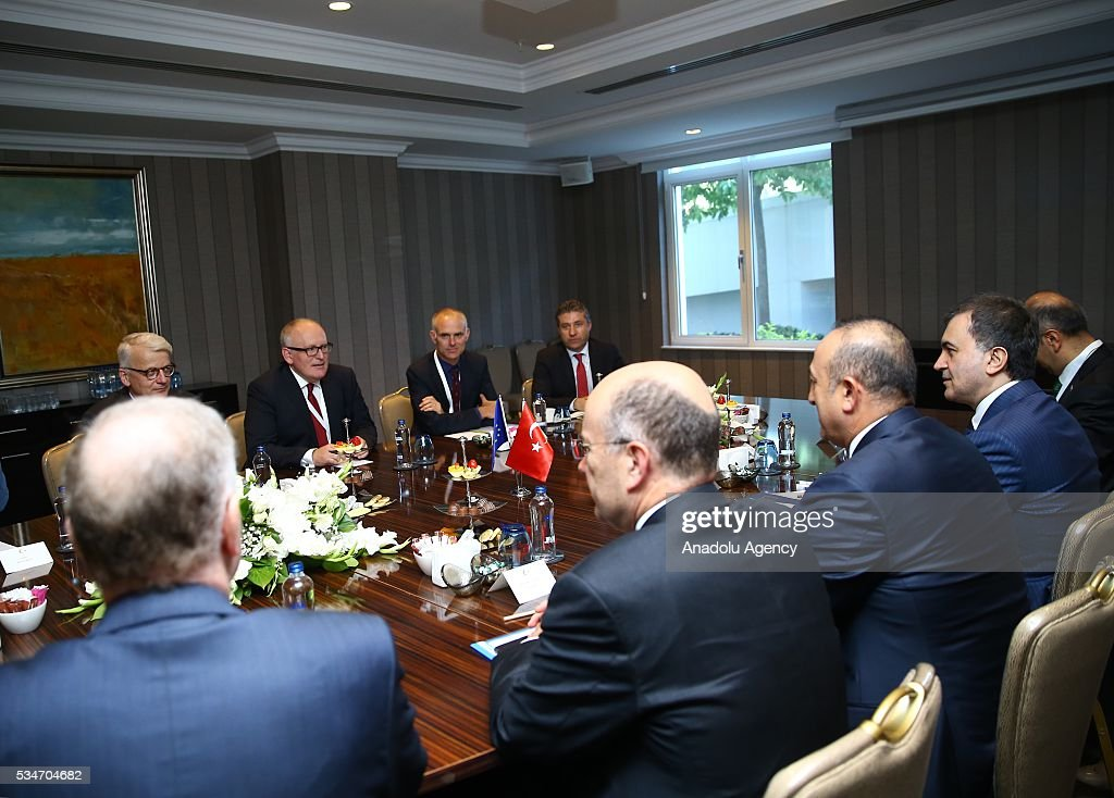 Turkish Foreign Minister Mevlut Cavusoglu (right 2), Turkish Minister of EU Affairs Omer Celik (right) and First Vice President of the European Commission Frans Timmermans attend a trilateral meeting within the Midterm Review of the Istanbul Programme of Action in Antalya, Turkey on May 27, 2016. The Midterm Review conference for the Istanbul Programme of Action for the Least Developed Countries takes place in Antalya, Turkey from 27 to 29 of May 2016. The conference undertakes a comprehensive review of the implementation of the Istanbul Programme of Action by the least developed countries (LDCs) and their development partners and likewise reaffirm the global commitment to address the special needs of the LDCs.