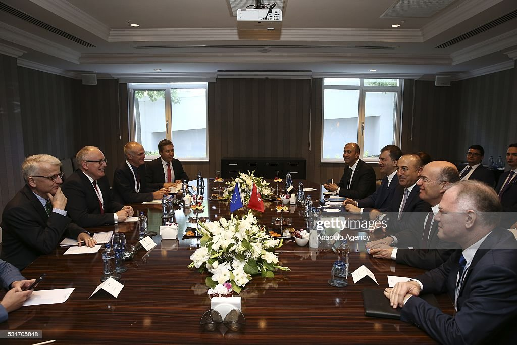 Turkish Foreign Minister Mevlut Cavusoglu (3rd R), Turkish Minister of EU Affairs Omer Celik (4th R) and First Vice President of the European Commission Frans Timmermans (2nd L) attend a trilateral meeting held within the Midterm Review of the Istanbul Programme of Action in Antalya, Turkey on May 27, 2016. The Midterm Review conference for the Istanbul Programme of Action for the Least Developed Countries takes place in Antalya, Turkey from 27 to 29 of May 2016. The conference undertakes a comprehensive review of the implementation of the Istanbul Programme of Action by the least developed countries (LDCs) and their development partners and likewise reaffirm the global commitment to address the special needs of the LDCs.
