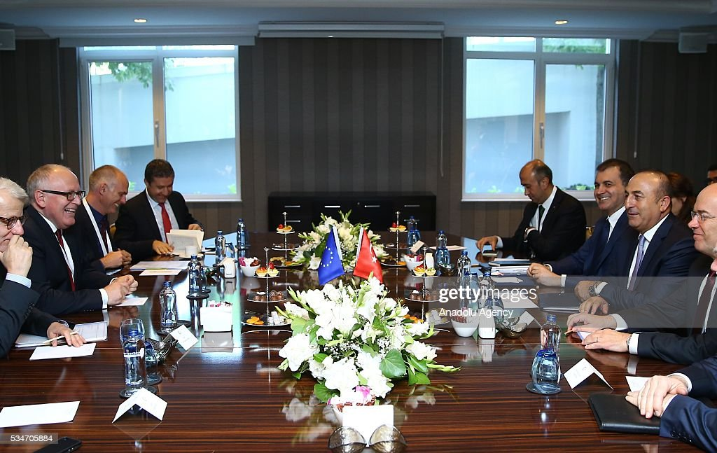 Turkish Foreign Minister Mevlut Cavusoglu (right 2), Turkish Minister of EU Affairs Omer Celik (right 3) and First Vice President of the European Commission Frans Timmermans (left 2) attend a trilateral meeting within the Midterm Review of the Istanbul Programme of Action in Antalya, Turkey on May 27, 2016. The Midterm Review conference for the Istanbul Programme of Action for the Least Developed Countries takes place in Antalya, Turkey from 27 to 29 of May 2016. The conference undertakes a comprehensive review of the implementation of the Istanbul Programme of Action by the least developed countries (LDCs) and their development partners and likewise reaffirm the global commitment to address the special needs of the LDCs.