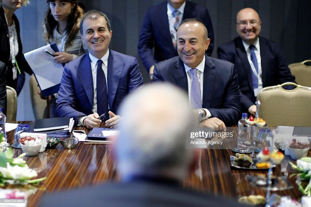 Turkish Foreign Minister Mevlut Cavusoglu (R), Turkish Minister of EU Affairs Omer Celik (L) and First Vice President of the European Commission Frans Timmermans (not seen) attend a trilateral meeting held within the Midterm Review of the Istanbul Programme of Action in Antalya, Turkey on May 27, 2016. The Midterm Review conference for the Istanbul Programme of Action for the Least Developed Countries takes place in Antalya, Turkey from 27 to 29 of May 2016. The conference undertakes a comprehensive review of the implementation of the Istanbul Programme of Action by the least developed countries (LDCs) and their development partners and likewise reaffirm the global commitment to address the special needs of the LDCs.