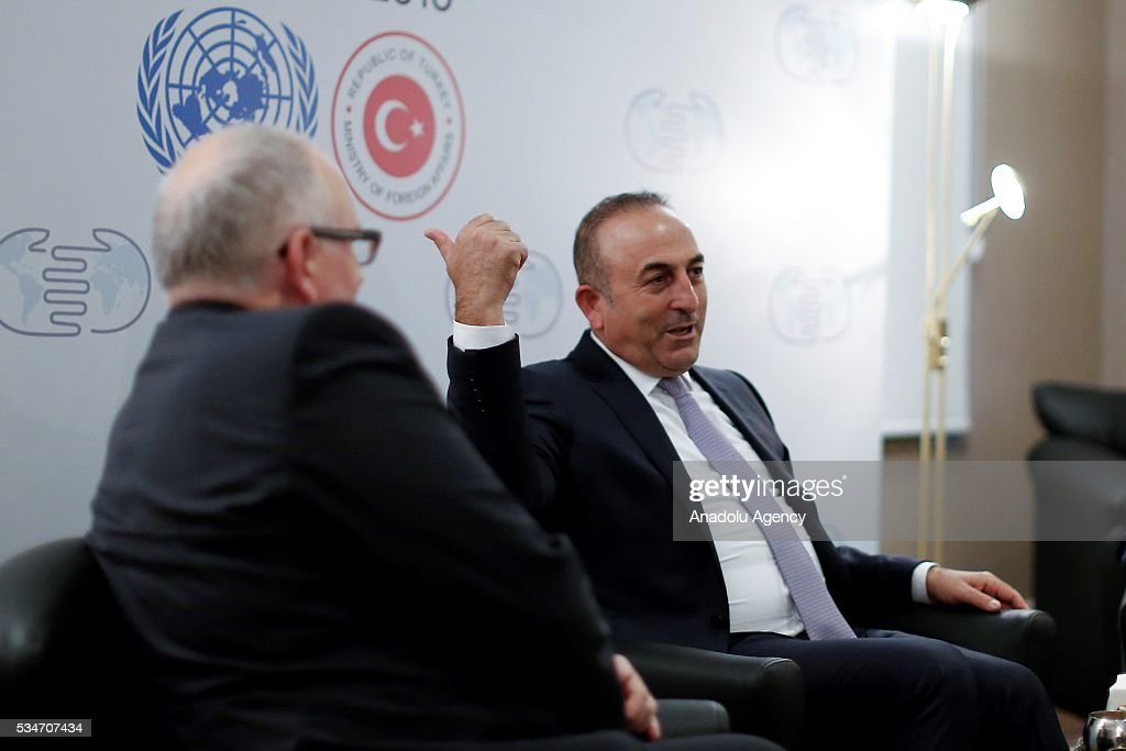 Turkish Foreign Minister Mevlut Cavusoglu (R), Turkish Minister of EU Affairs Omer Celik (not seen) and First Vice President of the European Commission Frans Timmermans (L) attend a trilateral meeting held within the Midterm Review of the Istanbul Programme of Action in Antalya, Turkey on May 27, 2016. The Midterm Review conference for the Istanbul Programme of Action for the Least Developed Countries takes place in Antalya, Turkey from 27 to 29 of May 2016. The conference undertakes a comprehensive review of the implementation of the Istanbul Programme of Action by the least developed countries (LDCs) and their development partners and likewise reaffirm the global commitment to address the special needs of the LDCs.