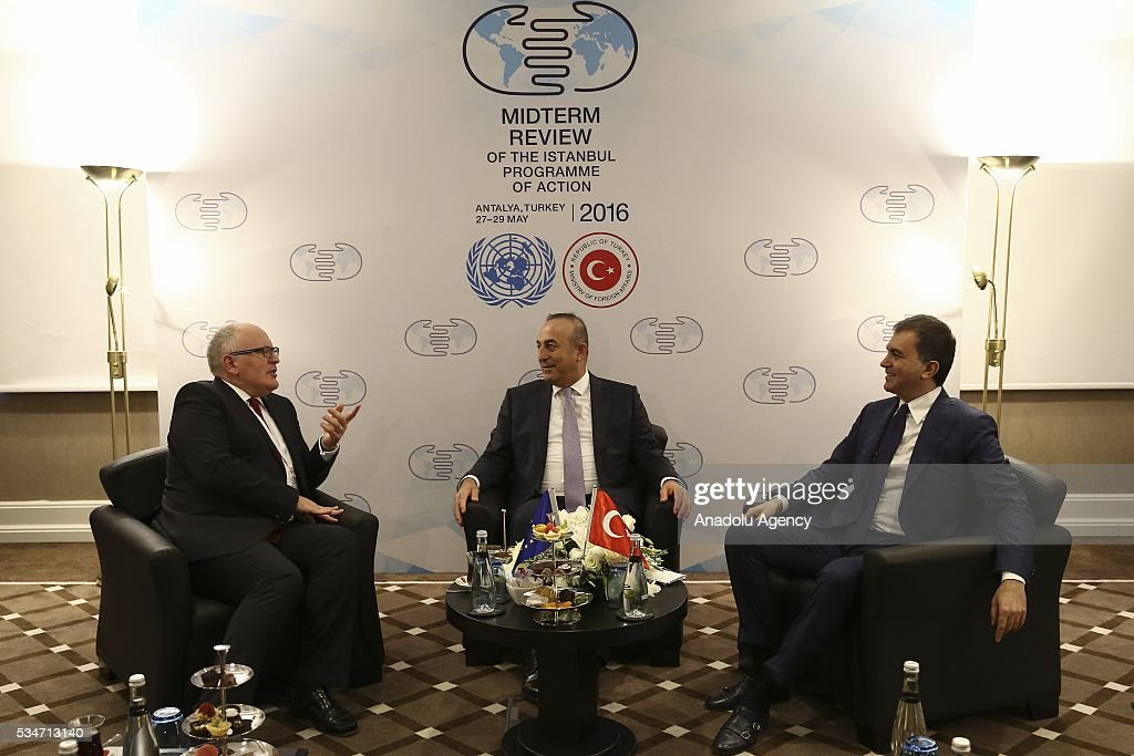 Turkish Foreign Minister Mevlut Cavusoglu (C), Turkish Minister of EU Affairs Omer Celik (R) and First Vice President of the European Commission Frans Timmermans (L) attend a trilateral meeting held within the Midterm Review of the Istanbul Programme of Action in Antalya, Turkey on May 27, 2016. The Midterm Review conference for the Istanbul Programme of Action for the Least Developed Countries takes place in Antalya, Turkey from 27 to 29 of May 2016. The conference undertakes a comprehensive review of the implementation of the Istanbul Programme of Action by the least developed countries (LDCs) and their development partners and likewise reaffirm the global commitment to address the special needs of the LDCs.