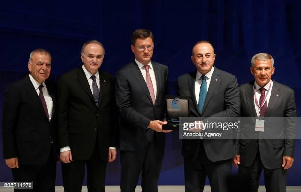 Turkish Foreign Minister Mevlut Cavusoglu Turkish Minister of Science Industry and Technology Faruk Ozlu and Izmir Metropolitan Municipality Mayor...