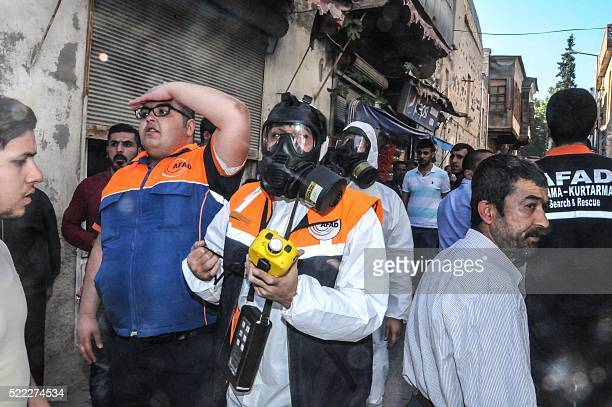 Turkish forensic investigators make chemical tests on April 18 2016 in Kilis after four rockets fired from Syria slammed into the southern Turkish...