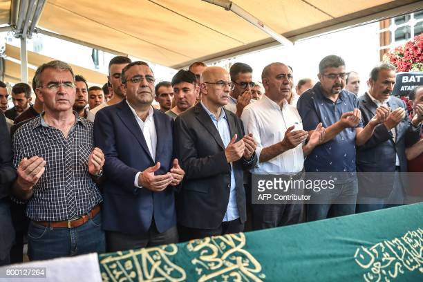 Turkish former journalist turned CHP lawmaker Enis Berberoglu prays as he attends his stepfather's funeral on June 23 2017 in Istanbul Turkey's main...