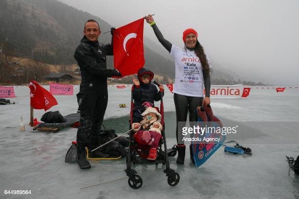 Turkish free diver Derya Can Gocen poses for a photo with her husband Tayfun Gocen her 14 months old daughter Derin Helen and her 6 years old son...