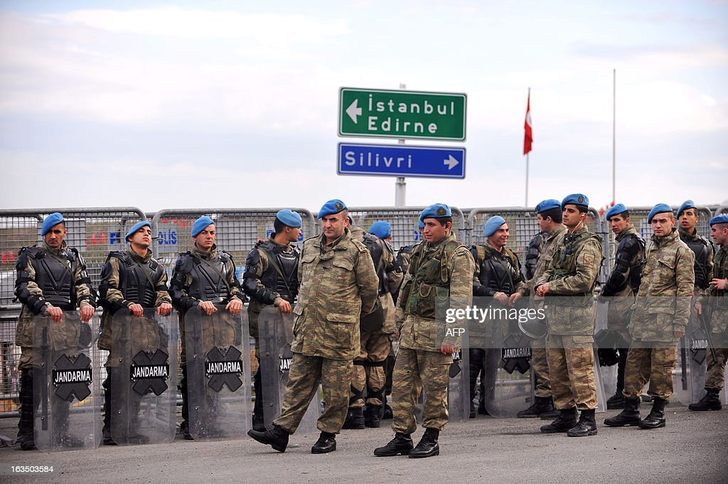 Turkish gendarmerie block the road to the courthouse in Silivri near Istanbul on March 11, 2013 where prosecutors are scheduled to deliver their final arguments in the case against 275 people accused of plotting to overturn the Islamic-leaning government. A verdict in the four-year long case involving 275 defendants, including Turkey's former military chief Ilker Basbug and other army officers as well as lawyers, academics and journalists, is expected in the coming weeks. The defendants face dozens of charges, ranging from membership in an underground 'terrorist organisation' known as Ergenekon and instigating an armed uprising against Erdogan and his Justice and Development Party (AKP), which came to power in 2002. AFP PHOTO/OZAN KOSE