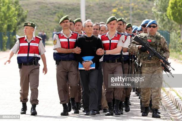 TOPSHOT Turkish Gendarmerie escort defendants Akin Ozturk and others involved in last Julys attempted coup in Turkey as they leave the prison where...