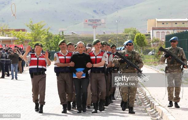 Turkish Gendarmerie escort defendants Akin Ozturk and others involved in last Julys attempted coup in Turkey as they leave the prison where they are...