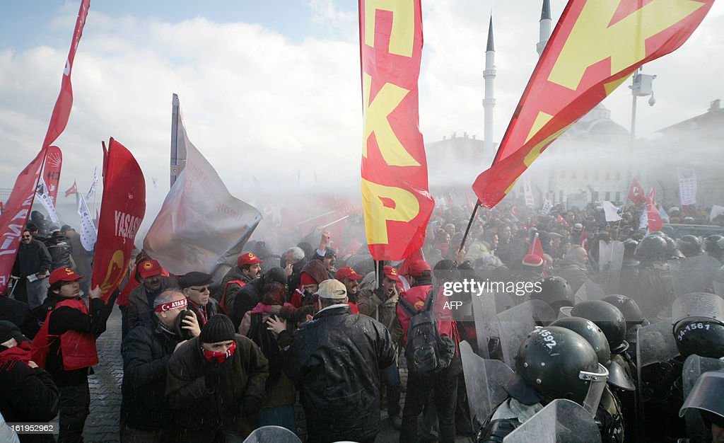 Turkish gendarmerie fire water cannon and tear gas as they clash with hundreds of protesters trying to enter a courthouse in Silivri near Istanbul on February 18, 2013 where prosecutors are scheduled to deliver their final arguments in the case against 275 people accused of plotting to overturn the Islamic-leaning government. A verdict in the four-year long case involving 275 defendants, including Turkey's former military chief Ilker Basbug and other army officers as well as lawyers, academics and journalists, is expected in the coming weeks. The defendants face dozens of charges, ranging from membership in an underground 'terrorist organisation' known as Ergenekon and instigating an armed uprising against Erdogan and his Justice and Development Party (AKP), which came to power in 2002.
