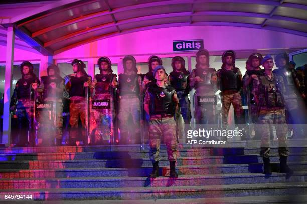 Turkish gendermes stand guard during the controversial trial of staff from Turkey's main opposition newspaper on September 11 2017 at the Silivri...