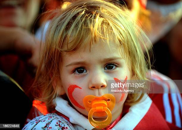 Turkish girl is seen at Gundogdu square during the celebration of Turkey's Republic Day on October 29 2013 in Izmir Turkey The Republic Day of Turkey...