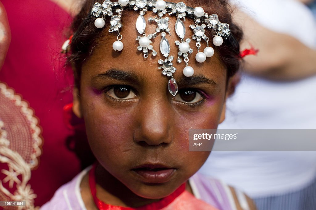 Turkish gypsie children is pictured during a celebration of the annual Spring Festival name is 'Hidirellez', on May 5, 2013, 2013, in Edirne, south-western Turkey. Gypsies celebrate the beginning of the Spring season according to their calendar. Hidirellez is celebrated as the day on which Prophets Hizir (Al-Khidr) and Ilyas (Elijah) met on the earth.